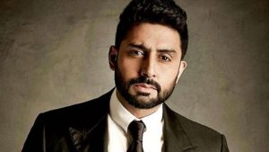 Abhishek Bachchan posing in black suit